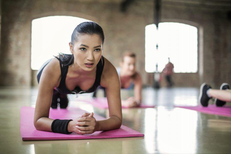 Women Doing Yoga on Yoga Mat